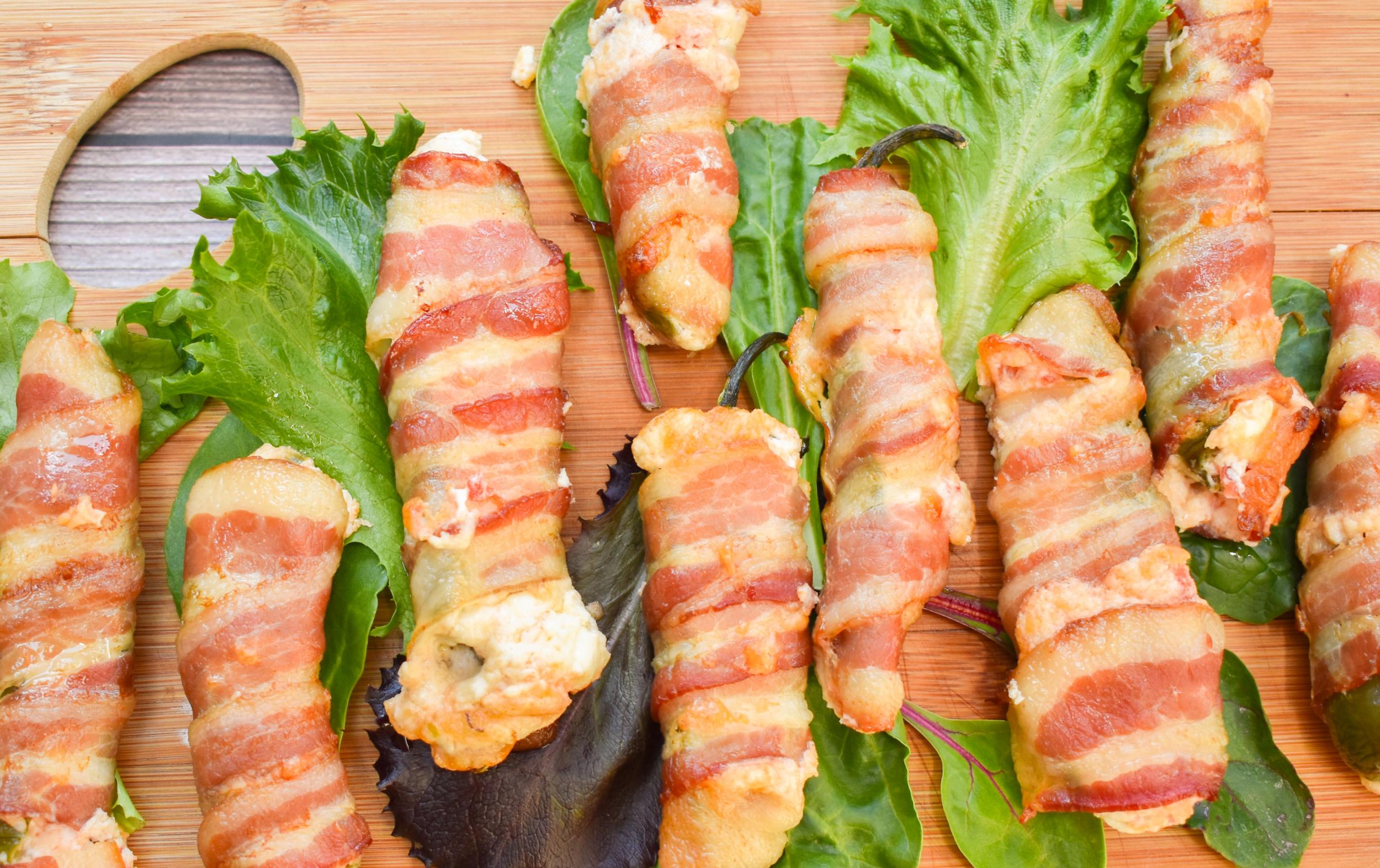 keto bacon jalapeño poppers on a wood board
