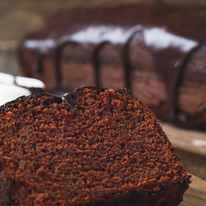 keto chocolate sour cream cake cake on wooden cutting board
