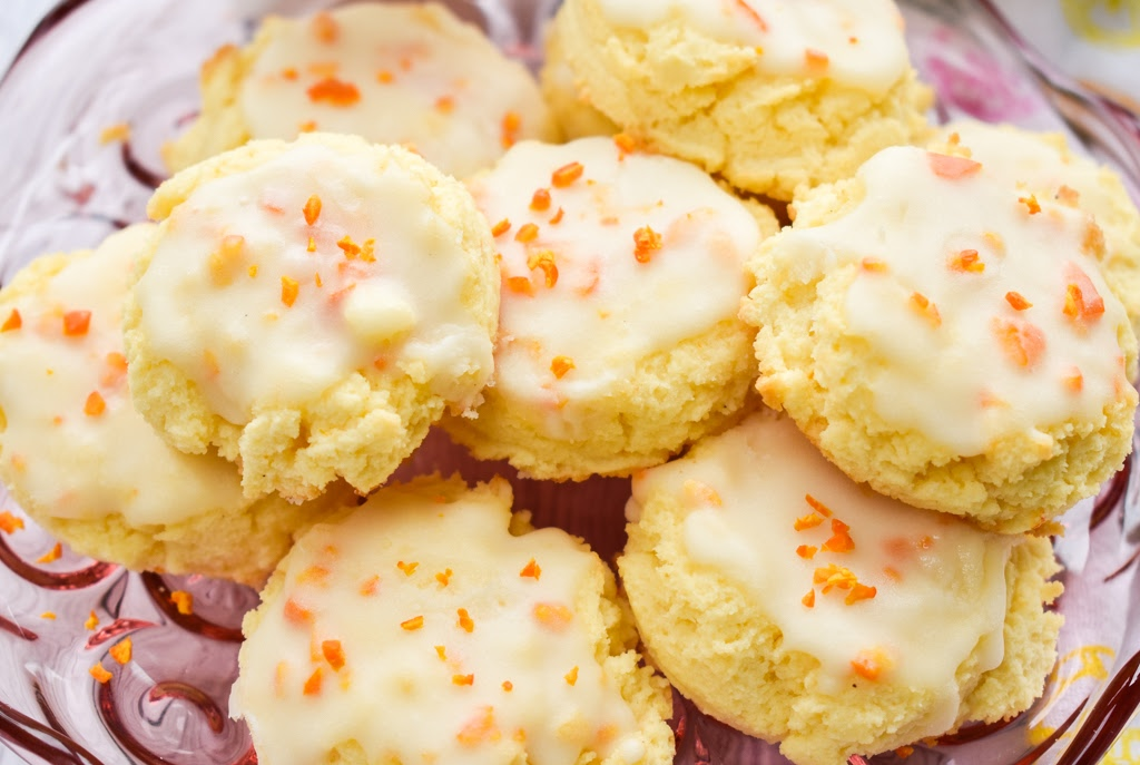 keto orange cookies on a pink clear plate stand