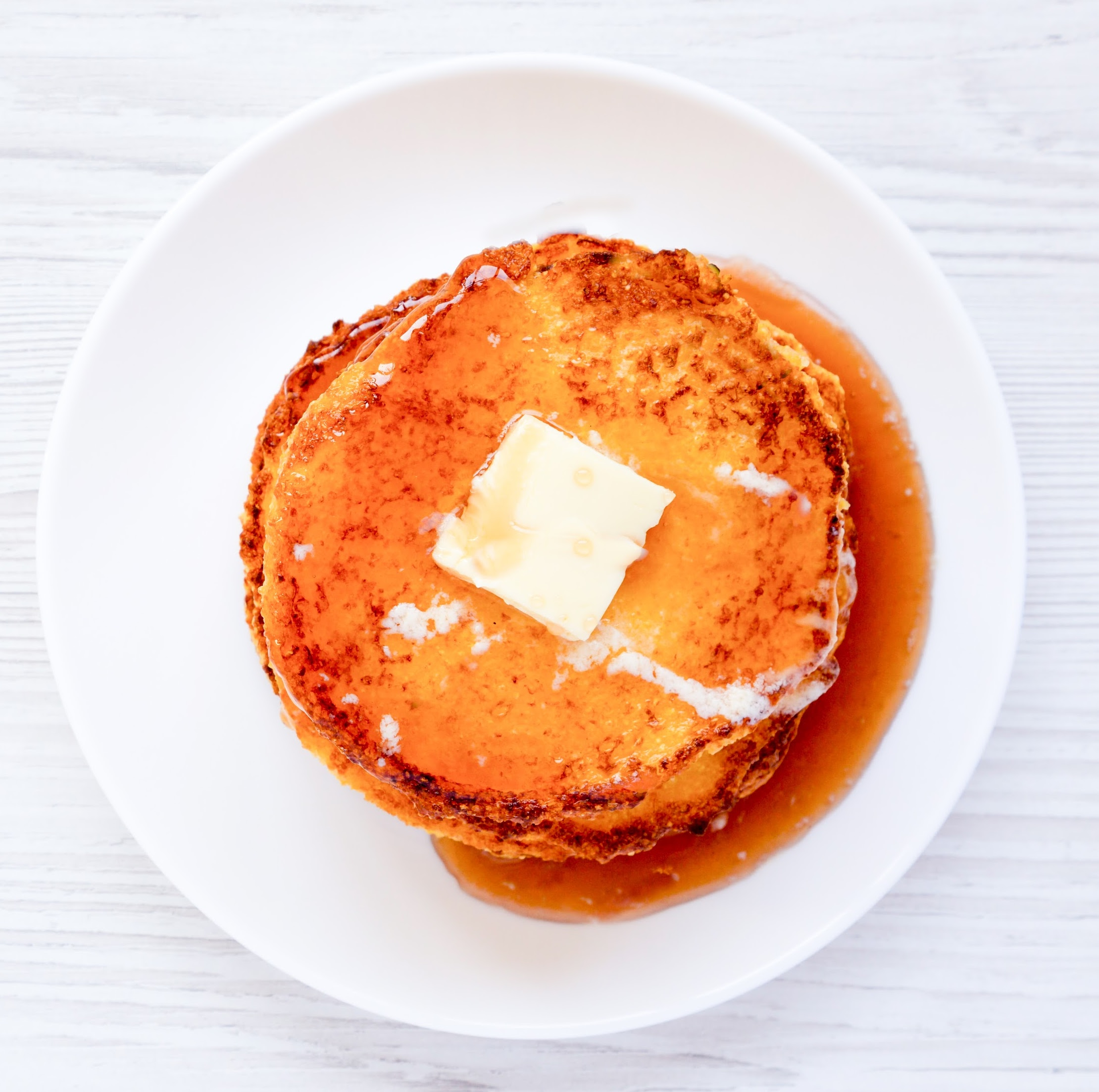 keto Johnny Cakes on a white plate and white table
