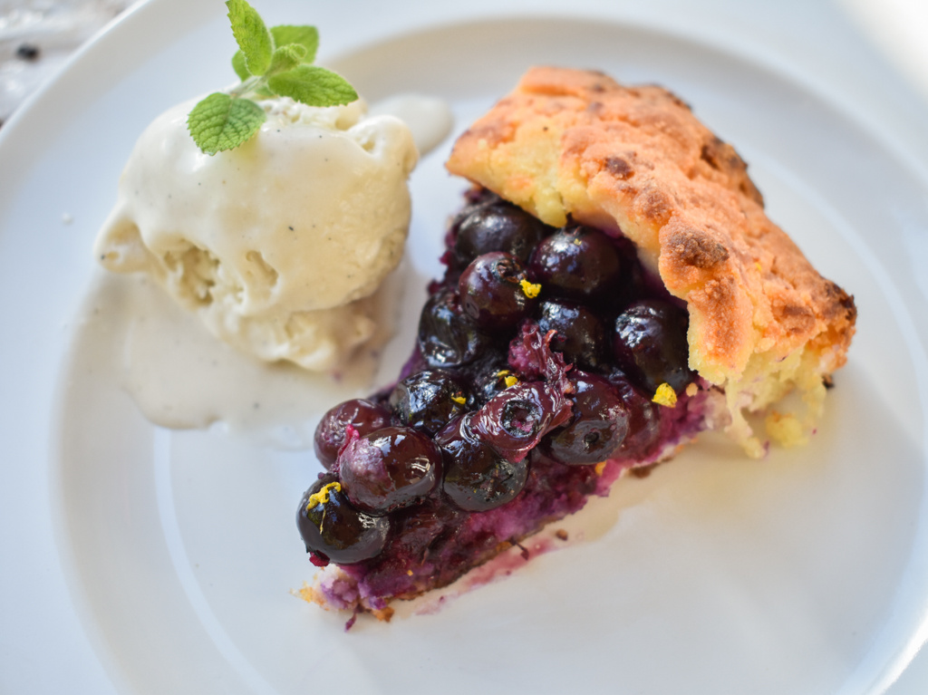 keto friendly blueberry galette with a scoop of vanilla ice cream