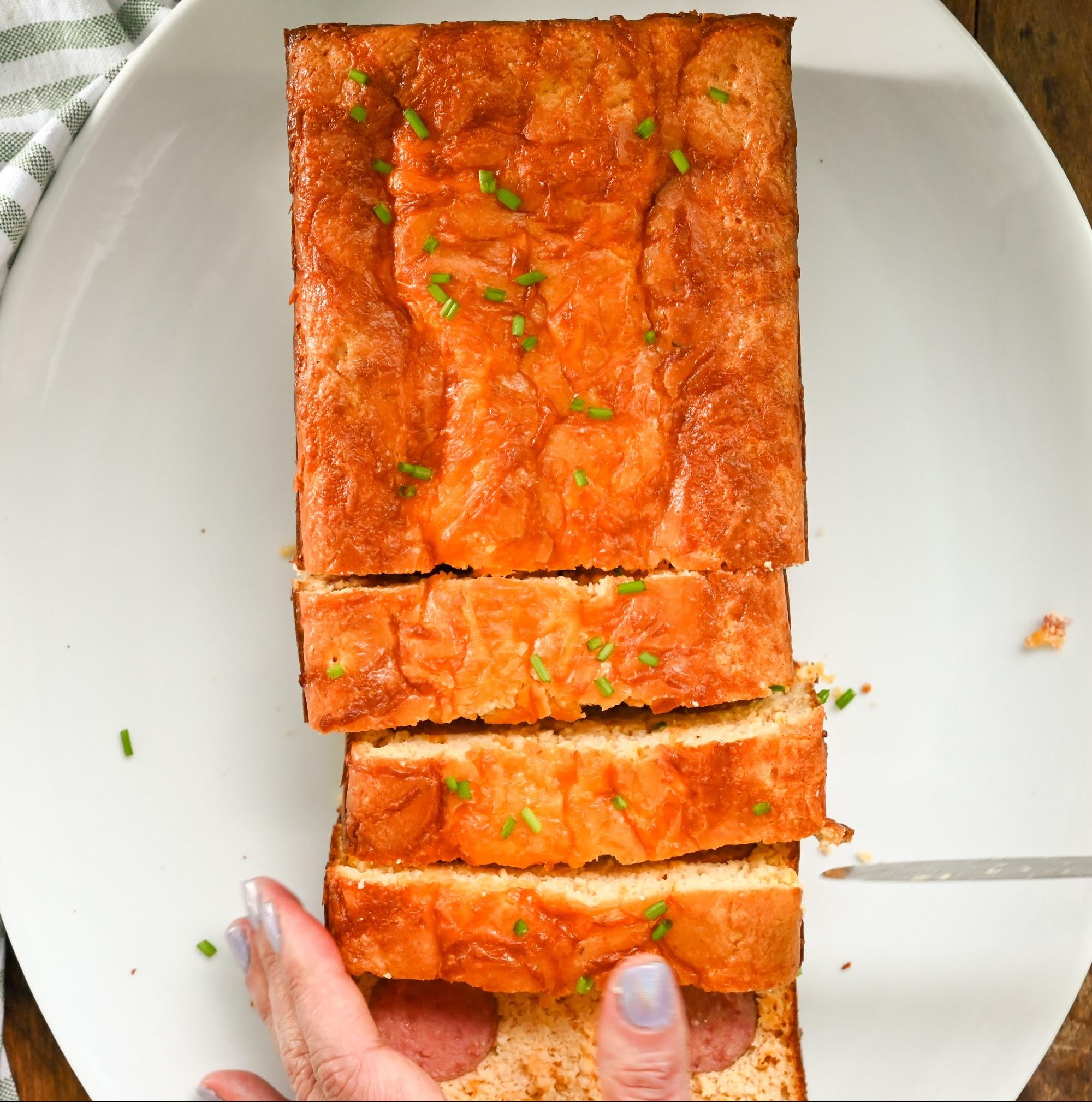 keto kielbasa cornbread loaf being sliced