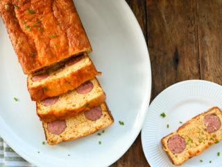 Keto kielbasa cornbread on a white plater sliced