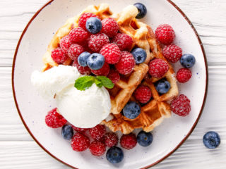 keto waffles served with blueberries and an ice cream scoop as dessert