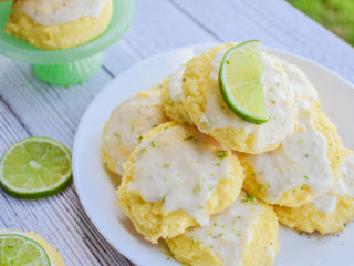 keto lime cookies served on a white plate and displayed on a white wood board