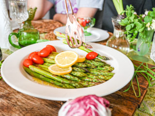 keto asparagus salad served on white plate on table