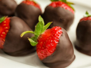 keto chocolate covered strawberries on a white plate