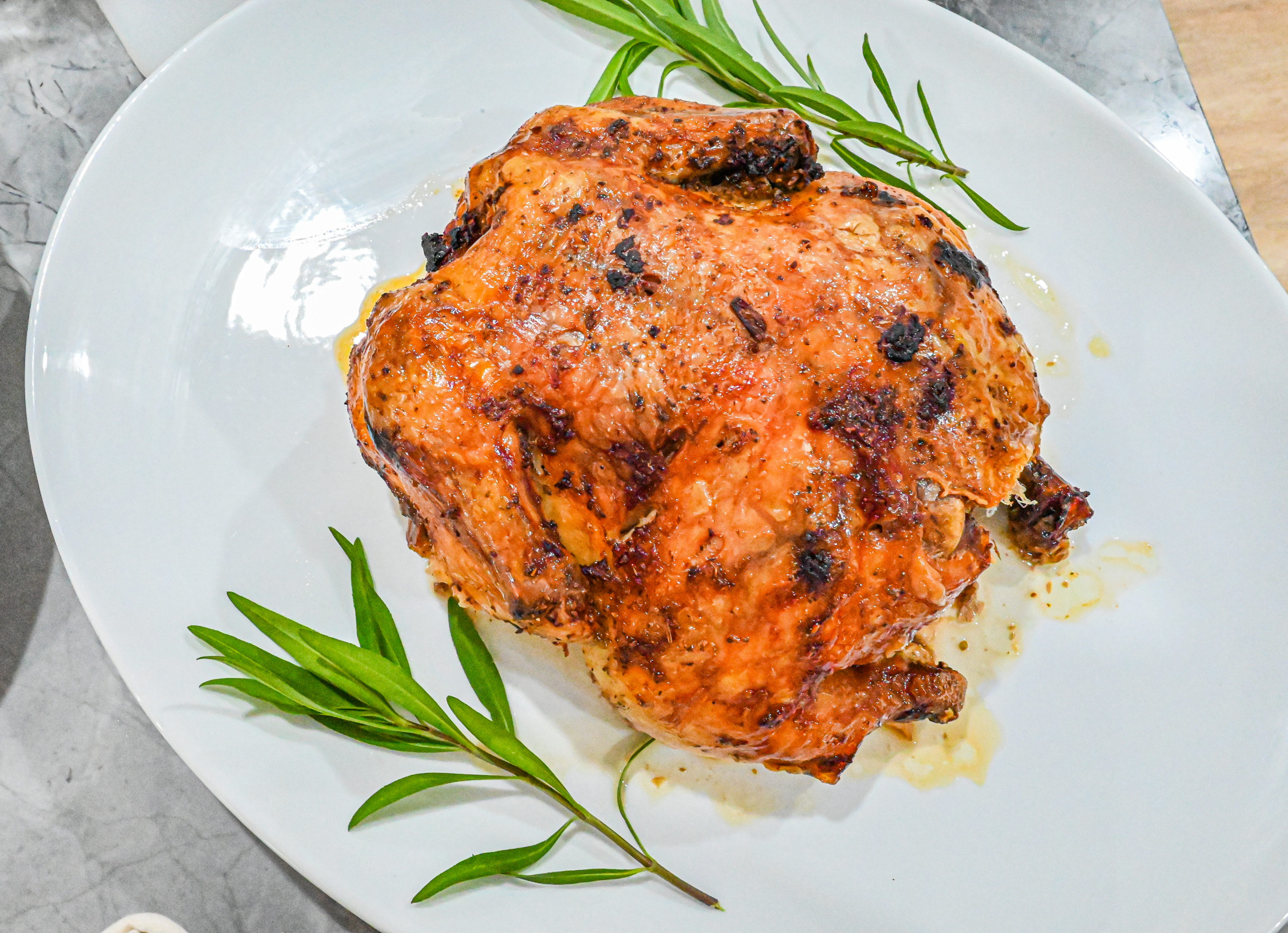 Keto Cuban Mojo Chicken on white plate with herbs