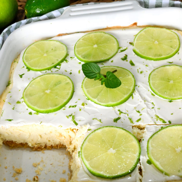 keto lime cheesecake bars with lime slices