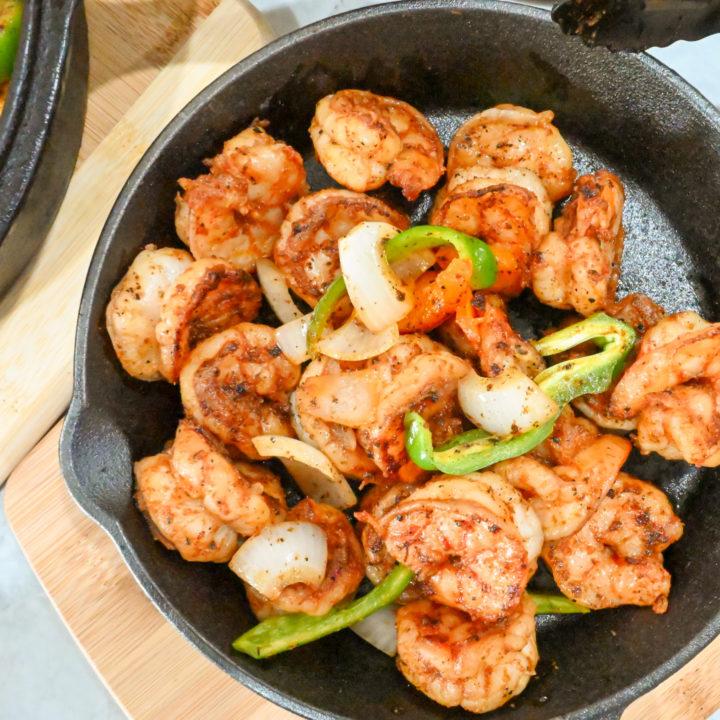 keto shrimp fajitas cooked in a black cast iron skillet