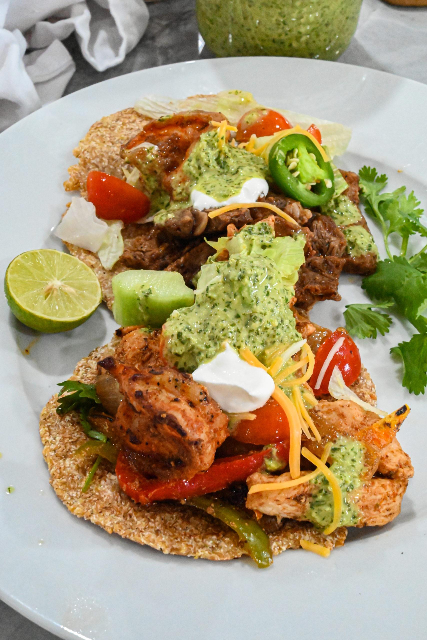 keto tacos with keto spicy cilantro garlic sauce drizzzled on top