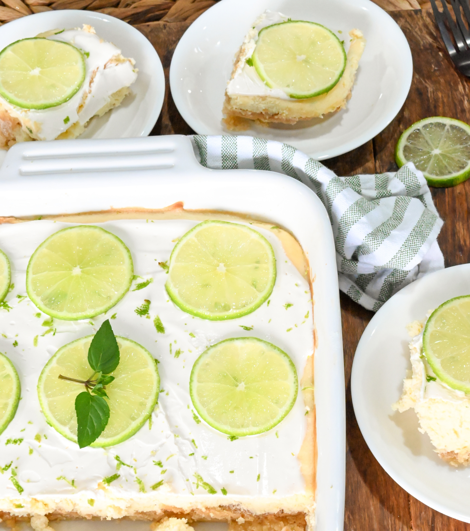 low carb lime cheesecake bars sliced and served on small white plates