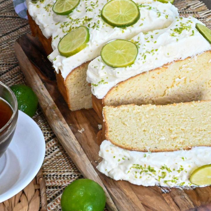 keto key lime pound cake sliced next to a cup of coffee