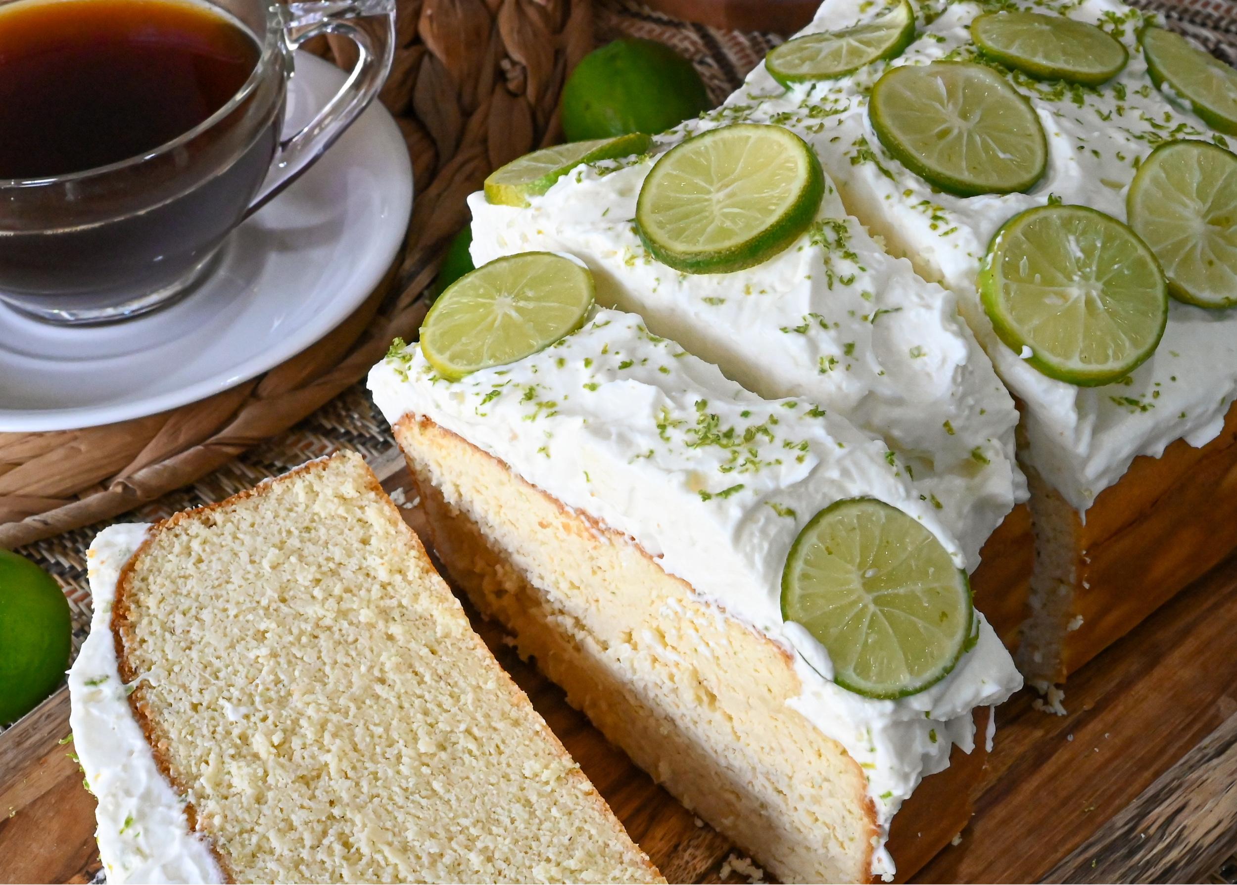 keto key lime pound cake sliced on a wood board