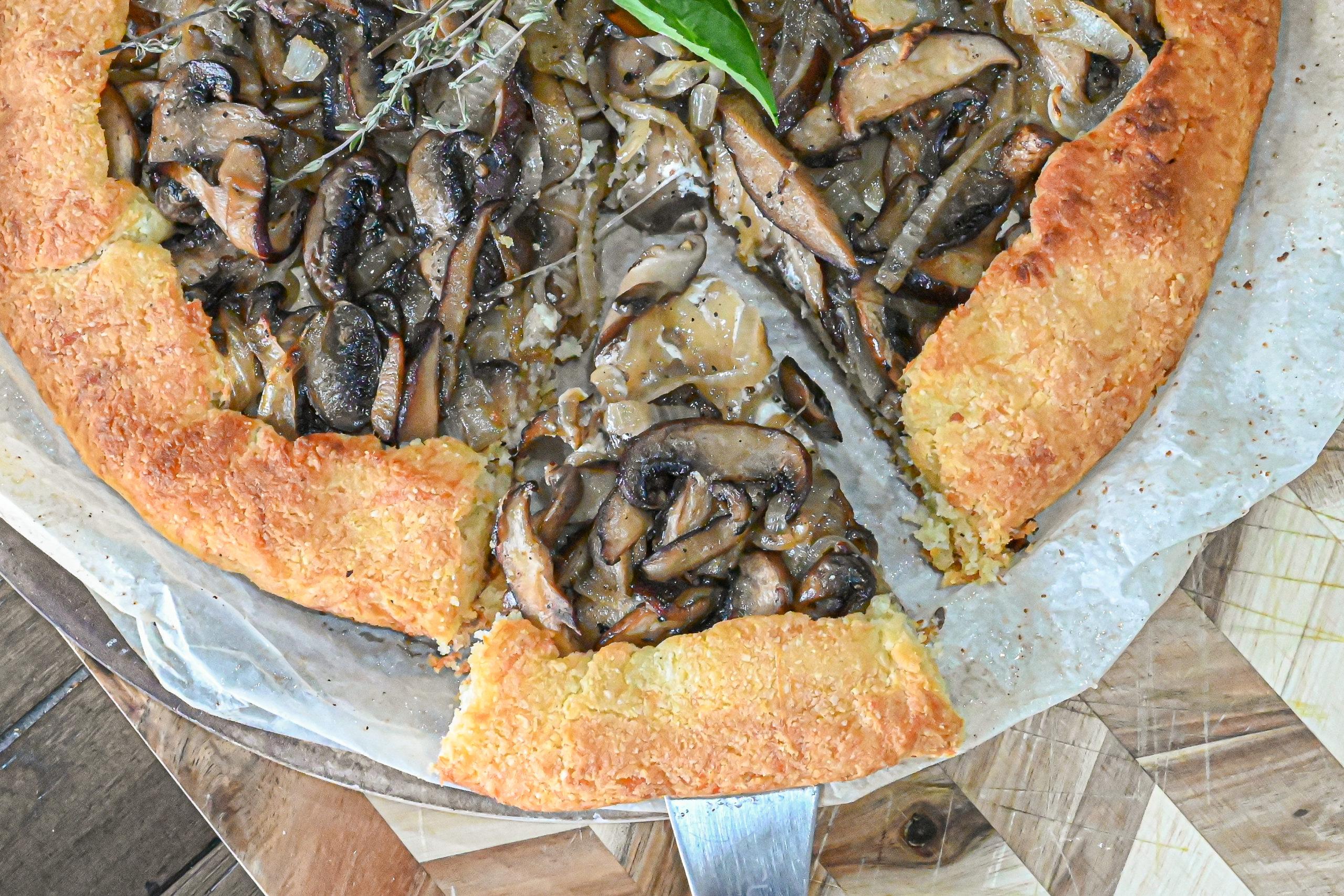 keto mushroom galette with slice being served