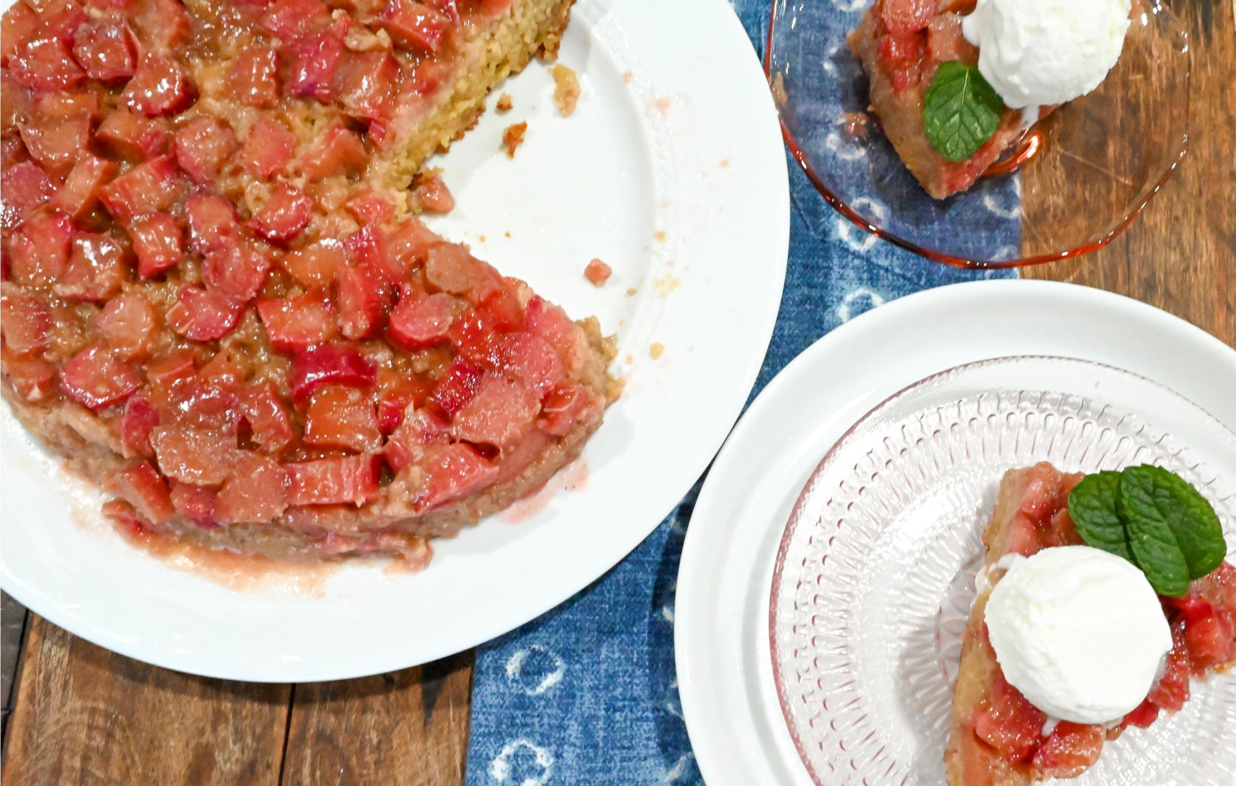 keto rhubarb upside down cake on a white cake plate