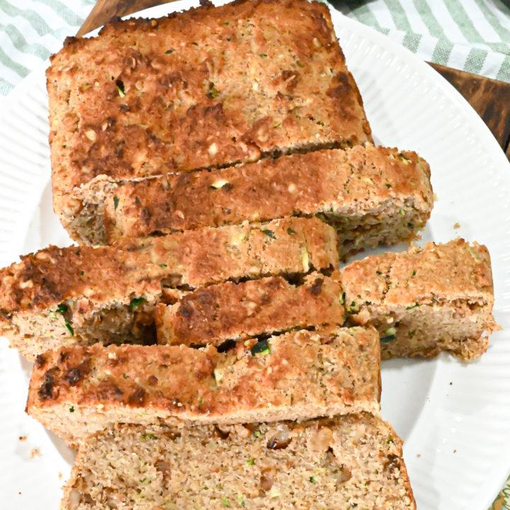 keto zucchini bread slices on white platter