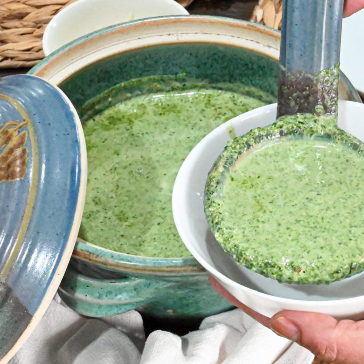 keto cream of spinach soup being served in a white small bowl