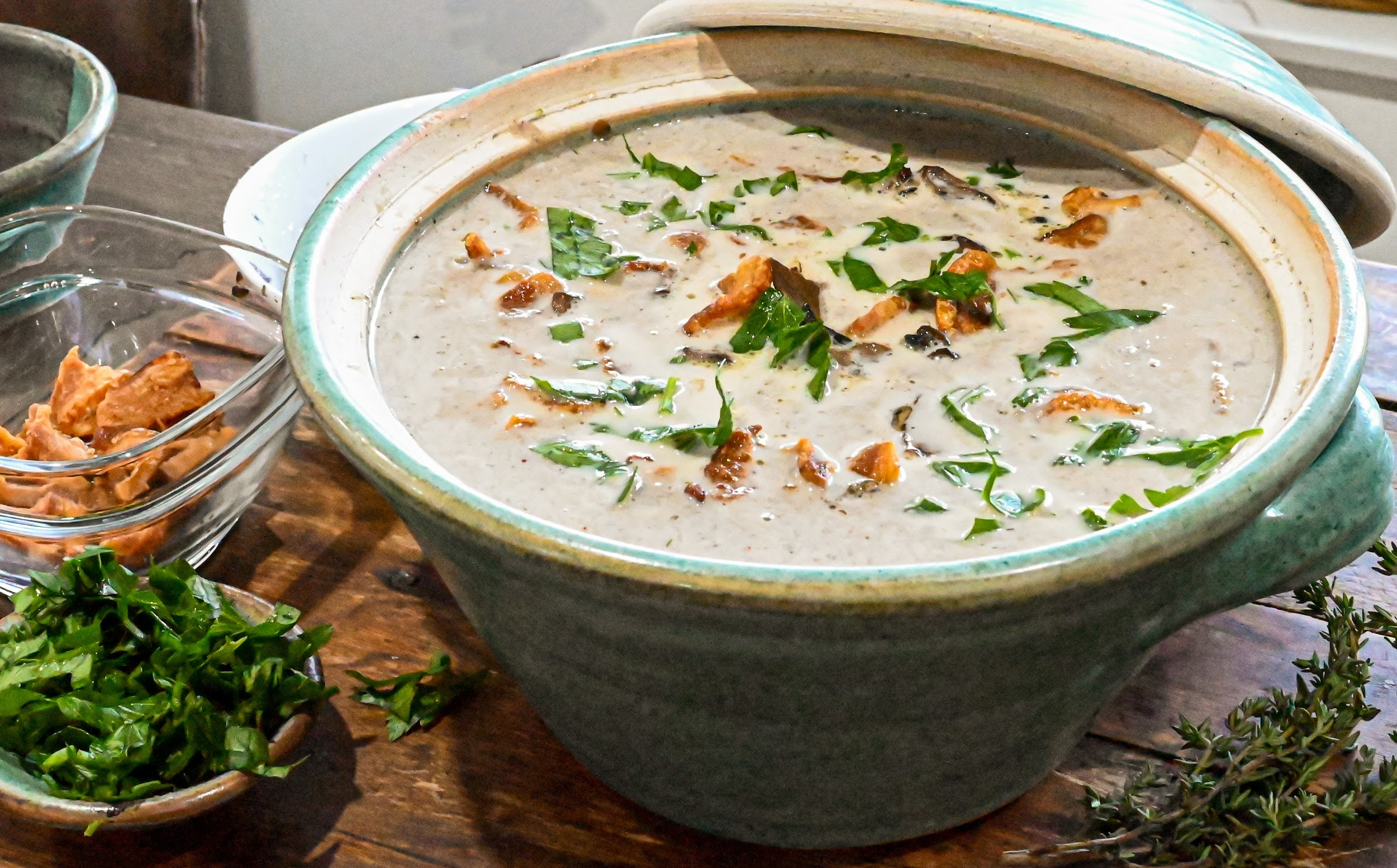 keto mushroom soup in a teal soup tureen ready to serve