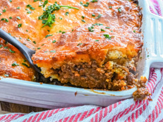 keto sloppy joe cornbread casserole slice being served with red and white striped towel